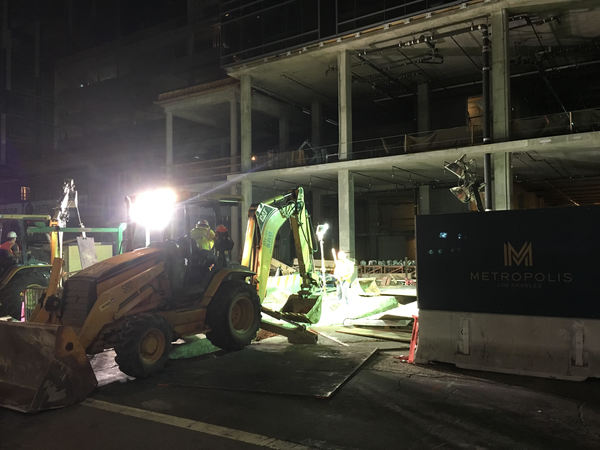 """Crews working late at Greenland's """"Metropolis"""" towers in downtown LA."""