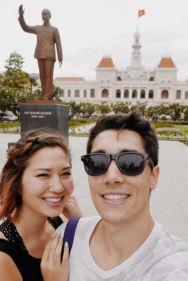 Taking pictures next to Uncle Ho (Ho Chi Minh) 's statue
