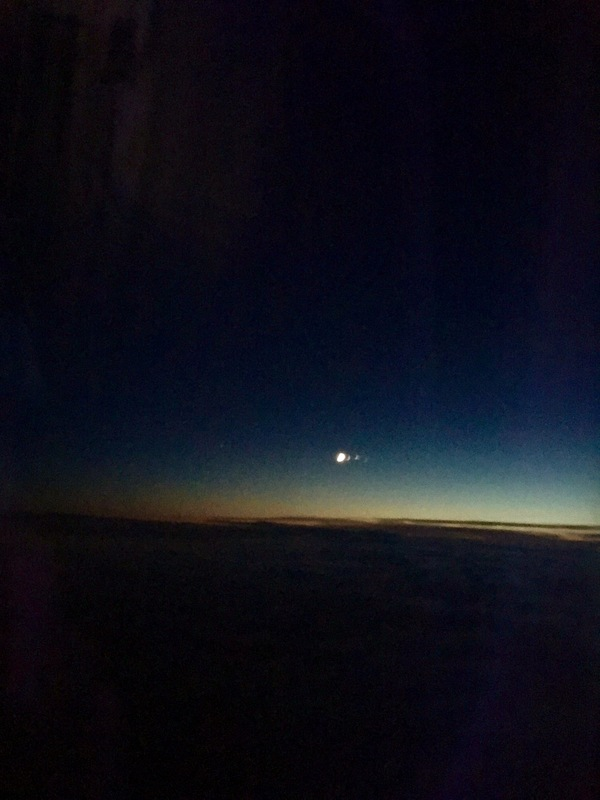 The moon while chasing a sunset.