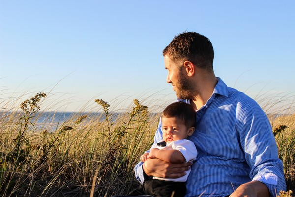 Me and baby Sagan at the beach on Cape Cod