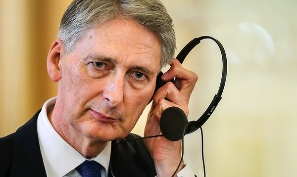 The U.K.'s finance minister Philip Hammond listening to the sound of his own voice
