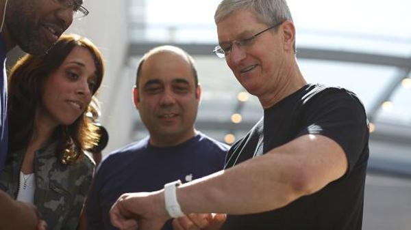 """Apple CEO Tim Cook Show's off Apple's latest """"device."""""""
