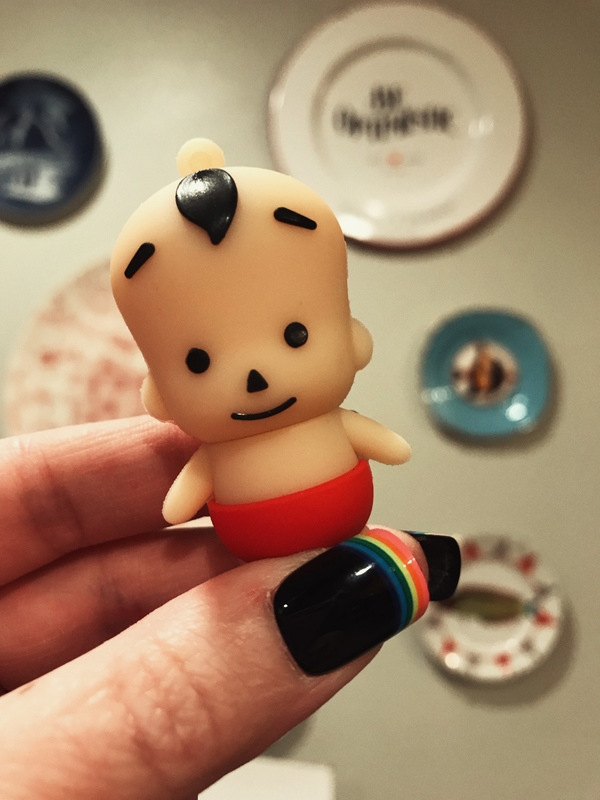 Not my child, just a whimsical flash drive. And yes, its head pops off to plug in.
