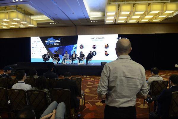 Source: De/Centralize. Ramani Ramachandran, Joseph Poon, Lasse Clausen, Meltem Demirors, Larry Salibra and Niraj Mehta (from left to right) at the closing panel of De/Centralize 2018
