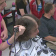 Students shave heads to raise money, awareness for pediatric cancer