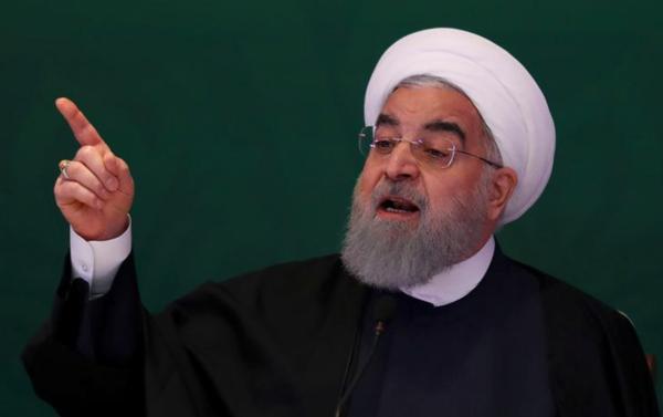 De Iraanse president Hassan Rouhani heeft geen zin de bestaande nucleaire deal open te breken om Trump gunstig te stemmen (foto: Reuters)