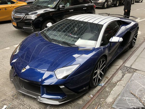 At NYC's Big Crypto Conference, the Lamborghinis Are Rented and Protests Are Staged
