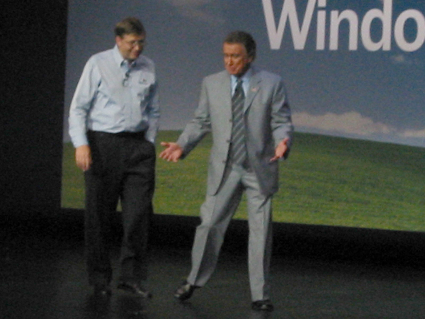 Bill Gates and Regis Philbin at the Windows XP launch in 2001, in a fuzzy photo I took with my Canon point-and-shoot (and which is only tangentially related to this piece).