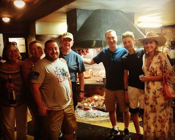 Lois, Krista, John, Bruce, Tod, Gabriel, and Tatiana admire the pit at Salt Lick BBQ.