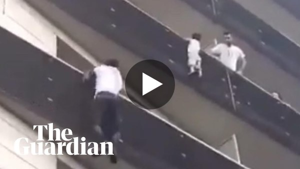 Paris hero climbs four-storey building to rescue dangling child - YouTube