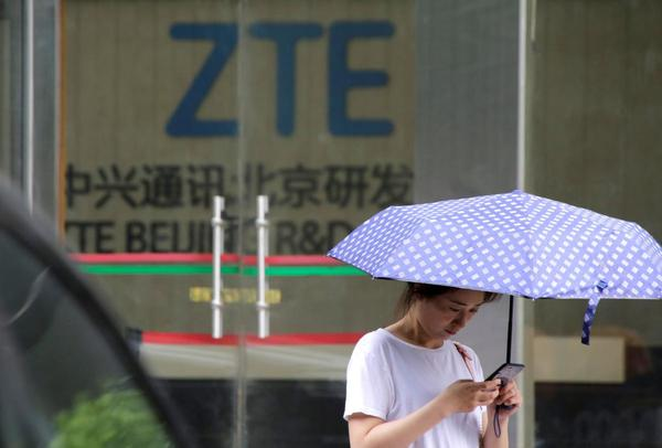 Investors wipe $3 billion off China's ZTE as US settlement sinks in | Reuters