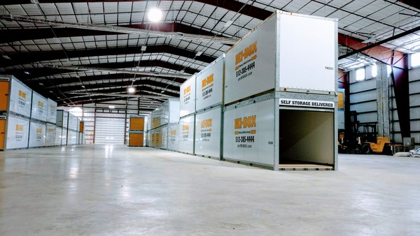 Mi-Box containers sit in their warehouse.