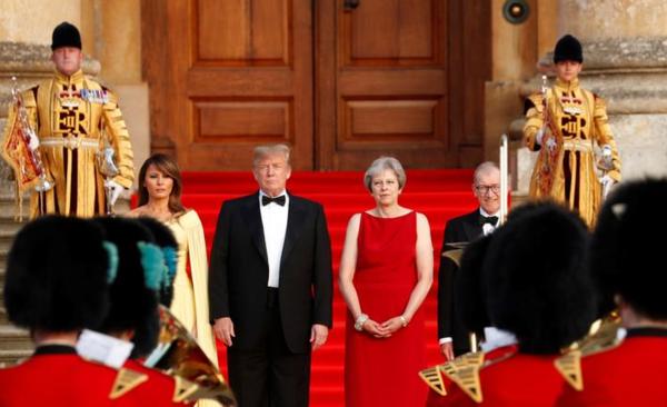 President Trump en premier May met partners voorafgaand aan het diner (Foto: Reuters)