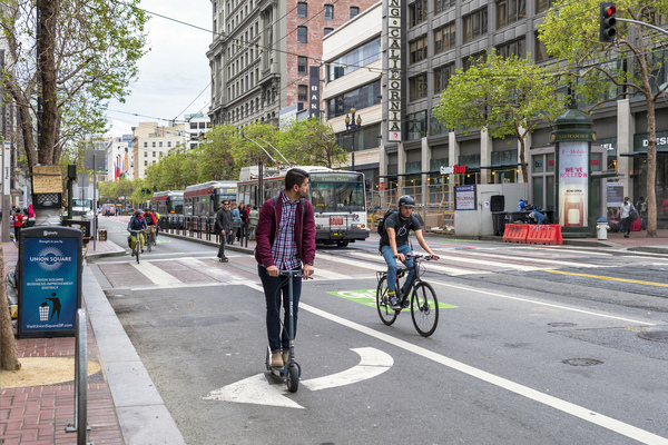 Bikes, scooters, skateboards, and buses in San Francisco by Sergio Ruiz