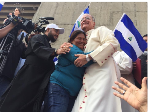 Doña Francisca Ramírez, a Nicaraguan campesino rights activist, hugs Bishop Silvio Baéz during march of support to Catholic Church on Saturday, July 28, in Managua, Nicaragua.