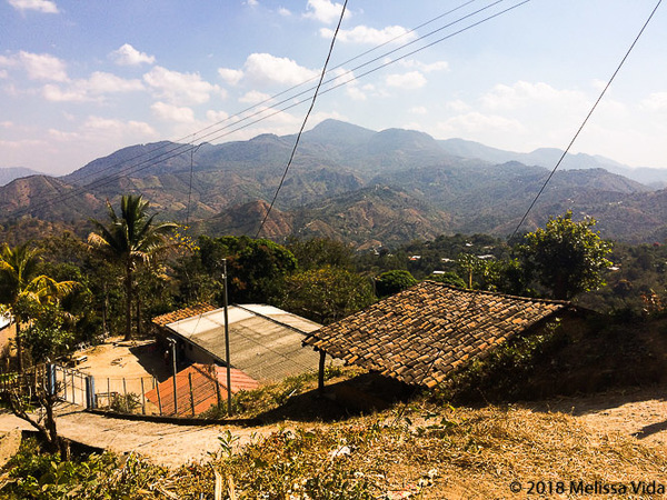 """Throwback to a reporting trip in Chalatenango, El Salvador. I snapped this picture quickly with my phone. In this department locally known as """"Chalate"""", I've heard stories about how villages are emptying due to decades of migration to the U.S. However, some people come back and build their houses in the area."""