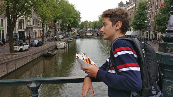 Gabo finishes his churros on a bridge over a canal in Amsterdam.