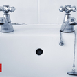 Why do homes in the UK have separate hot and cold taps?
