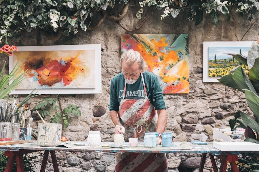 Man making art outdoors