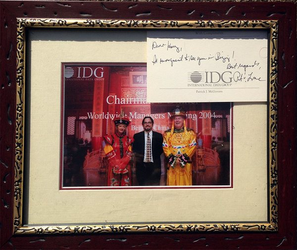Beijing 2004: Pat's wife Lore Harp McGovern, myself, and Pat (the McGoverns dolled up specifically to take a picture with every attendee of an IDG gala, and the signed note is typical Pat)
