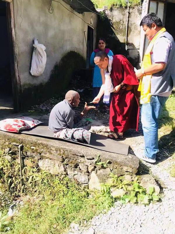 Charitable offering to an elderly community in Pokhara, Nepal