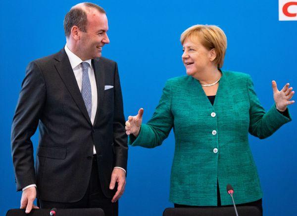 Manfred Weber en Angela Merkel