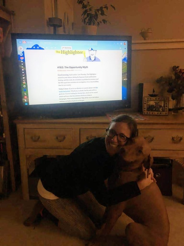 "Here's loyal reader Marni hugging her dog Indie with all her might. A subscriber for more than three years, Marni likes reading The Highlighter on the big screen. ""It's the only way!"" she says. (This is Indie's third appearance. See #29 and #116.)"