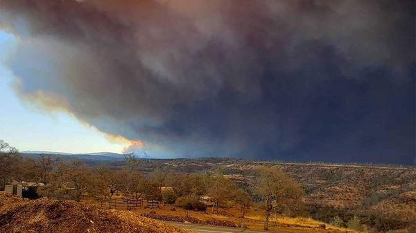 A Northern California fire is growing at a rate of about 80 football fields per minute