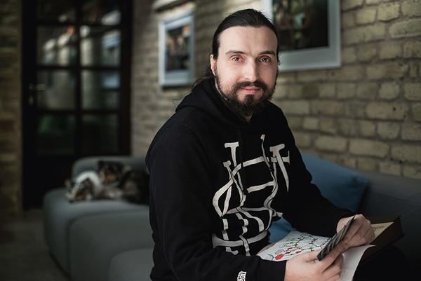 Alexey Bokulev in April 2015, holding the design notes for Gremlins, Inc.