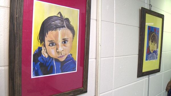 Students paint portraits of kindness for children abroad