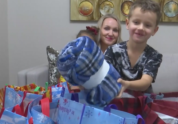 An autistic child gives special bags to the homeless