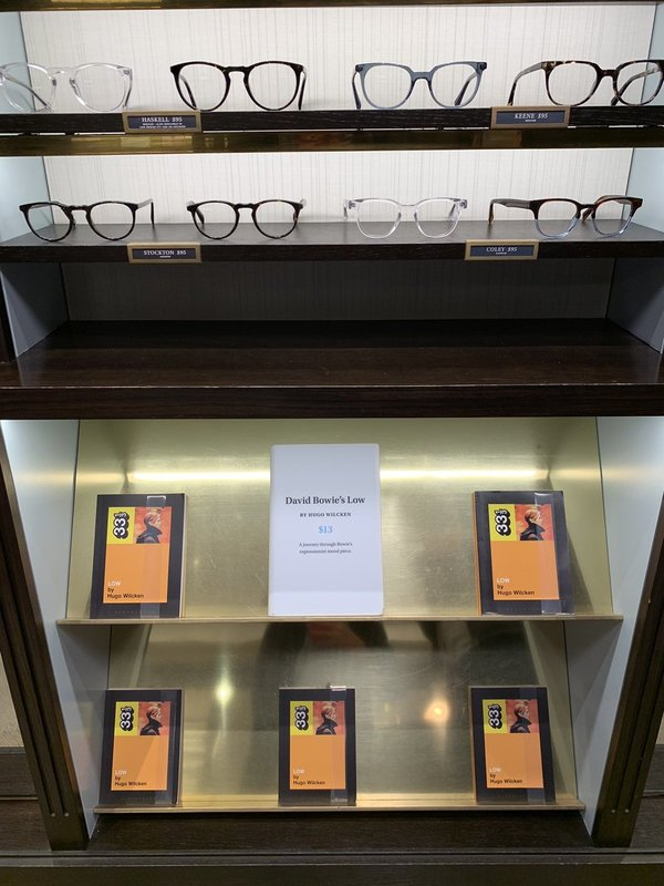 Warby Parker glasses alongside David Bowie books at the former's showroom in Chicago. (photo taken by me)