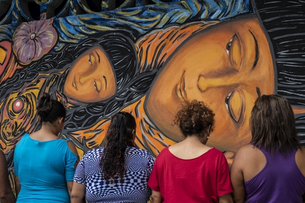 """""""A new mural decorates the streets of Tapachula, the busiest town on the Mexican side of the border with Guatemala. In vivid earthy tones, it depicts a woman holding a baby in her arms, sprinkled with the names of the two dozen women from north Central America who painted it and profound words capturing their aspirations: love, trust, freedom, safety."""" - UNCHR"""