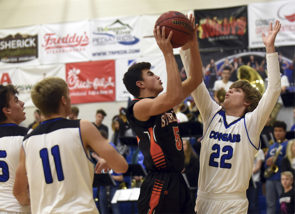 Sterling's Tucker Myers tries to make a shot over Resurrection Christian's Sparky Morris on Jan. 15 at Resurrection Christian High School in Loveland. (Photo by Joshua Polson)