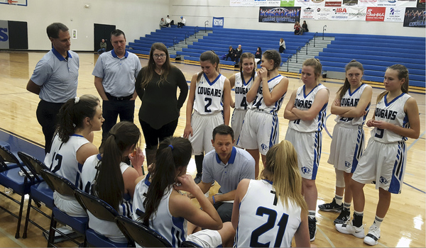 Resurrection Christian coach Jason Conrad discusses strategy with his team during its 35-24 win against Colorado Academy on Dec. 15 in Loveland. (Photo by Bobby Fernandez)