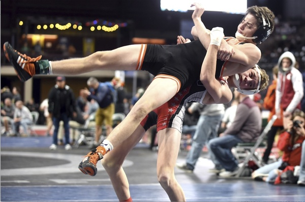 Eaton's Toby Gavette lifts Lewis-Palmer's Skyler Hunt off the ground in a 113-pound match Dec. 14 at the Northern Colorado Christmas Tournament at the Budweiser Events Center in Loveland. (Photo by Joshua Polson)