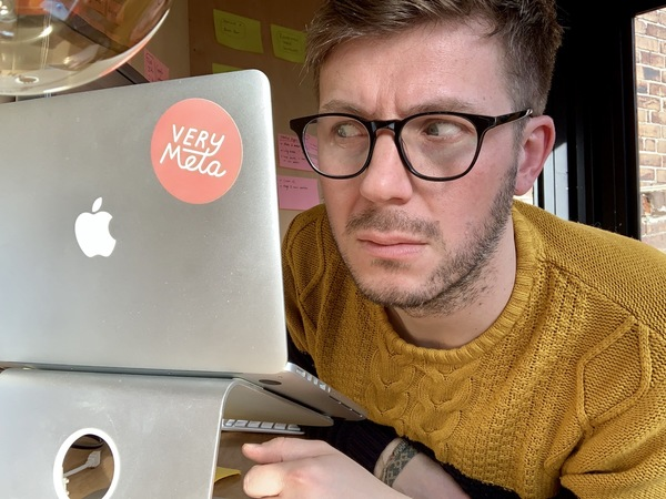 Me in my shed. Looking at a sticker. On a laptop.