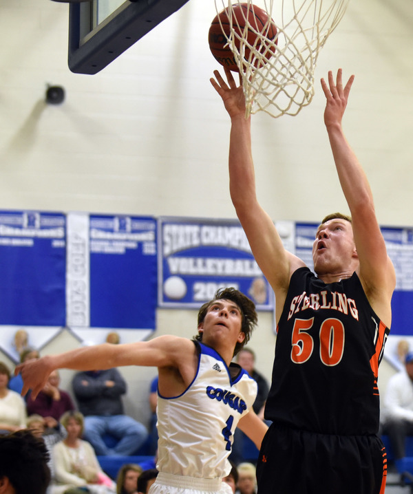 Sterling's Jace Pittman makes a shot while guarded by Resurrection Christian's Zach Cook on Jan. 15 at Resurrection Christian High School in Loveland. (Photo by Joshua Polson)
