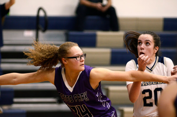 Olivia Hamel of Estes Park, left, blocks out Izzy Swanson of Liberty Common for a rebound Jan. 17 at Liberty Common High School. (Photo by Quinn Ritzdorf)