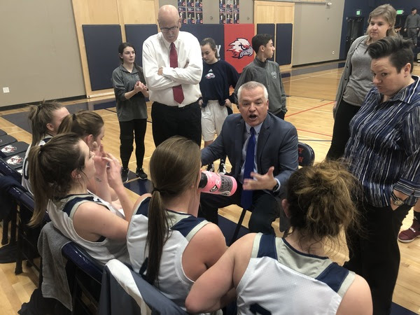 Liberty Common girls basketball coach Troy Ukasick talks to his team during a timeout against Estes Park on Jan. 17. Liberty Common won 37-30. (Photo by Quinn Ritzdorf)