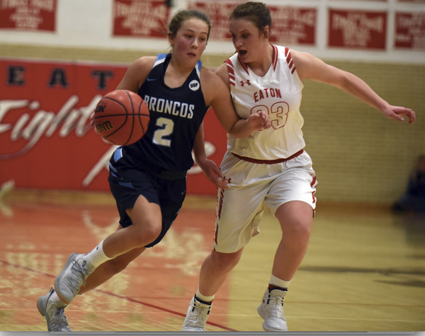 Platte Valley's Cora Schissler drives by Eaton's Mady Bruch on Jan. 11 at Eaton High School. (Photo by Joshua Polson)