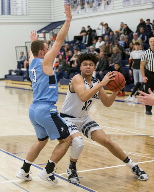Bulldogs junior Andre Chacon, right, works for a shot against Platte Valley's Trevon Wehrman on Feb. 1 at University Middle School in Greeley. (Photo by Michael Brian)