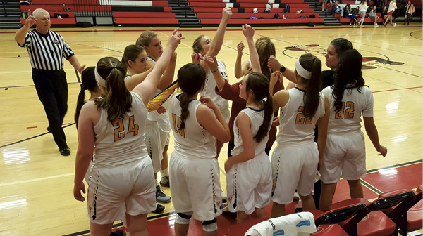 Valley's girls basketball team huddles during a 58-36 loss to The Academy on Nov. 29 in Eaton. (Photo by Bobby Fernandez)