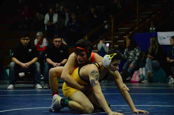 Valley's Isaiah Rios wrestles Sterling's Isaac De Leon in the 138-pound regional championship Saturday in Kersey. Rios won in a 3-0 decision. (Photo by Quinn Ritzdorf)