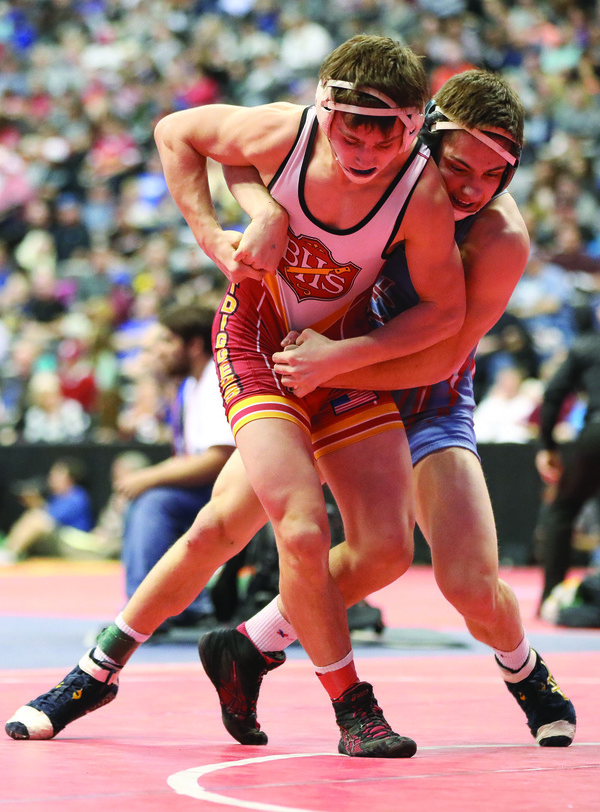 Weld Central's Jimmy LaConte wrestles Brush's Wyatt Pfau during a 152-pound match during the 2017 Class 3A Wrestling Championships at the Pepsi Center, 1000 Chopper Cir., in Denver. (Photo by Joshua Polson)