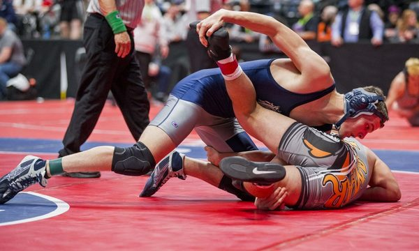 Platte Valley's Colton Moore, top, wrestles Lamar's Jesus Reyes on Thursday during the Class 3A Wrestling Championships at the Pepsi Center in Denver. Moore won with a pin. (Michael Brian/mbrian@greeleytribune.com)
