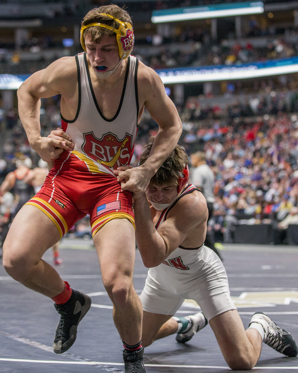 Brush's Wyatt Pfau tries to escape Eaton's Ty Garnhart during their championship match Saturday at the Class 3A Wrestling Championships at the Pepsi Center in Denver. Garnhart defeated Pfau for the championship. (Michael Brian/mbrian@greeleytribune.com)