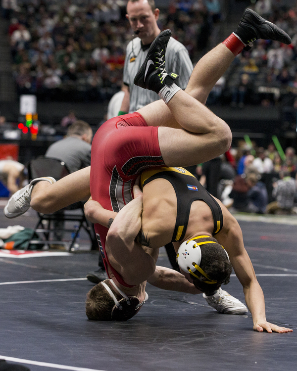 Valley's Isaiah Rios takes Eaton's Dylan Yancey down during their championship match Saturday at the Class 3A Wrestling Championships at the Pepsi Center in Denver. Rios defeated Yancey to win the 138-pound championship. (Michael Brian/mbrian@greeleytribune.com)