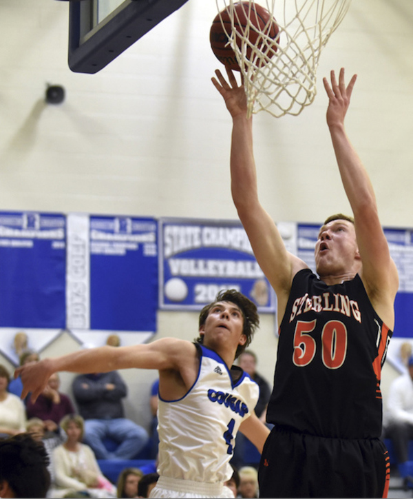 Sterling's, right, Jace Pittman makes a shot against Resurrection Christian's Zach Cook on Jan. 15 at Resurrection Christian High School in Loveland. (Photo by Joshua Polson)