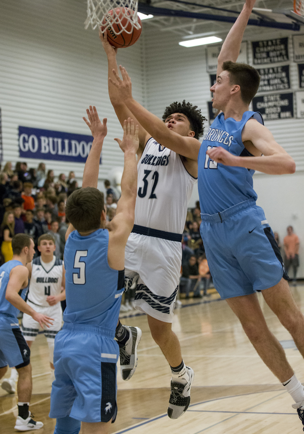 University High's Andre Chacon (32) shoots in the lane against the Platte Valley defense of Bryson Becker, right, and Kade McDaniel, left, on Feb. 1 in Greeley. (Michael Brian/mbrian@greeleytribune.com)